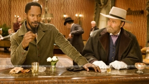 Django plays the part of a black slave owner to spike Candie's interests